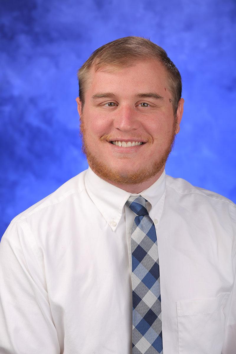 A head-and-shoulders professional photo of Ryan Hagarman
