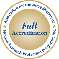 A round logo shows the words Association for the Accreditation of Human Research Protection Programs, Inc. around the outside and the words Full Accreditation in larger text inside the circle.