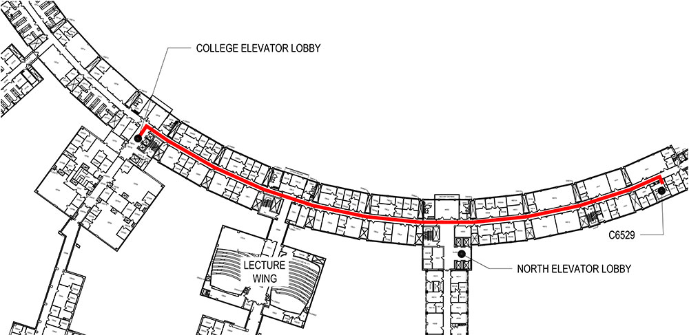A hallway map shows an arrow with a line drawn from the elevator lobbies of Penn State College of Medicine to Room C6529.