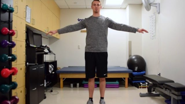 A still from a video shows a person performing the Arm Circles exercise.