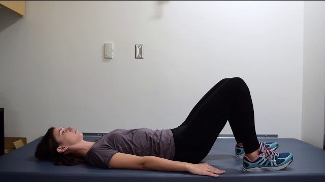 A still from a video shows a person performing the Bridges exercise.