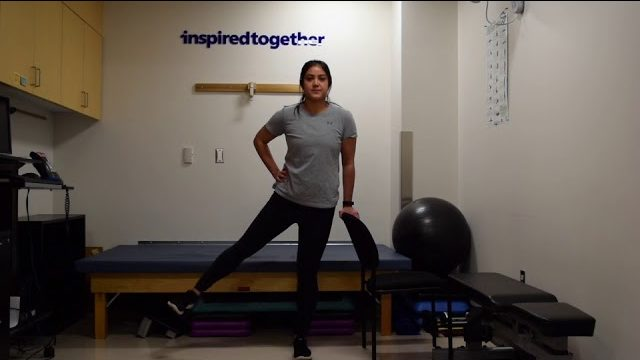 A still from a video shows a person performing the Hip Abduction exercise.