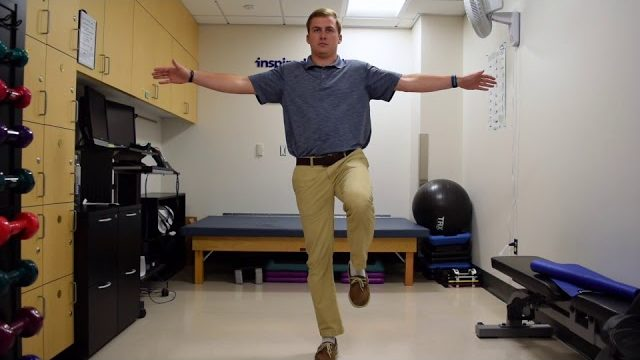 A still from a video shows a person performing the Single-Leg Stance exercise.