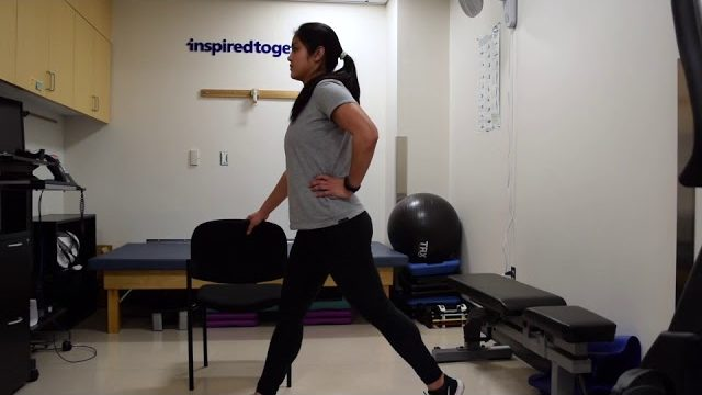 A still from a video shows a person performing the Split Squat exercise.