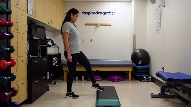 A still from a video shows a person performing the Toe Taps exercise.