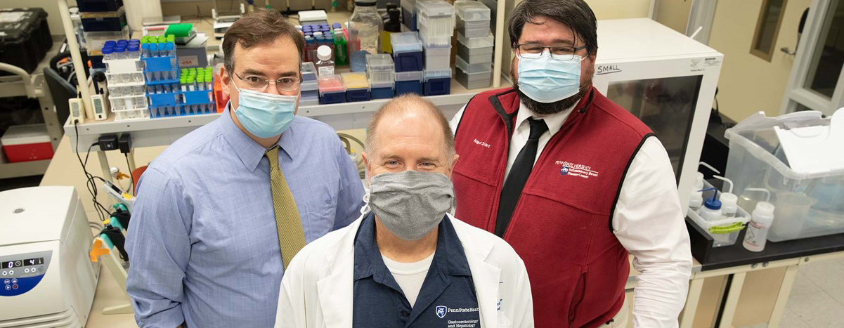 From left, Dr. Matthew Coates, Jeffrey Small and August Stuart pose for a portrait in Coates' lab.